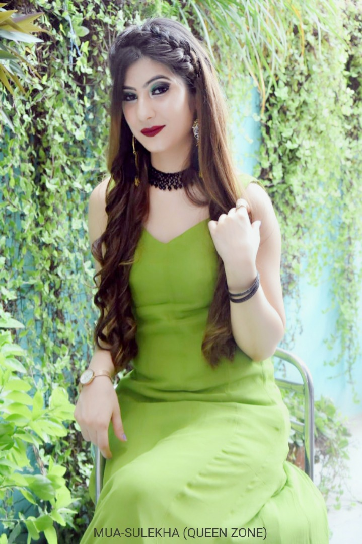 bride in green outfit and bold red lip