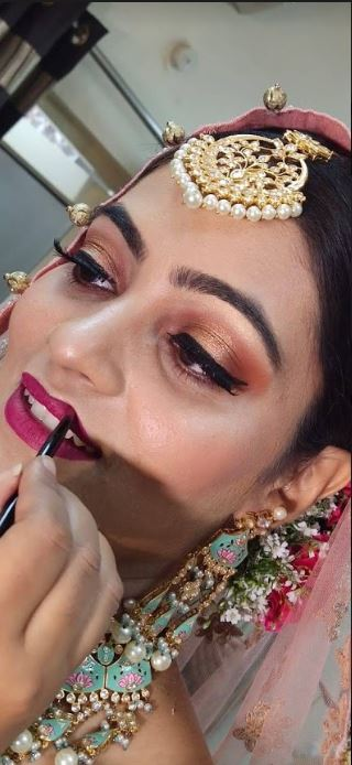 Glitter Eye Makeup and Pink Lips with Pink Bridal Outfit