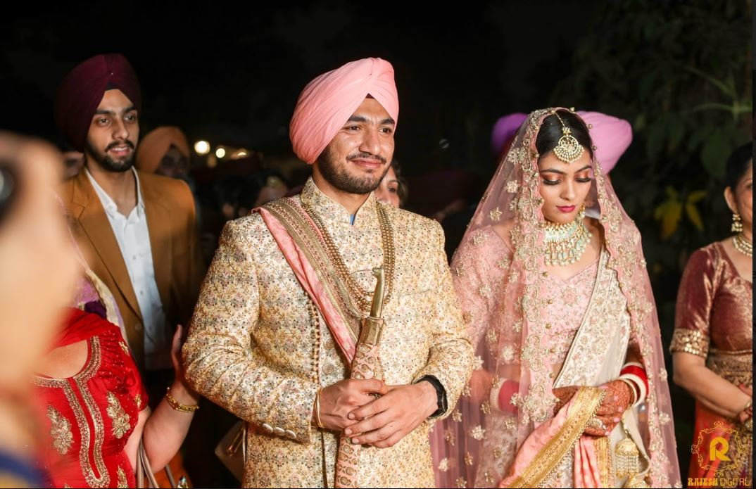 Sikh Bride and Groom in Coordinating Pink Outfits