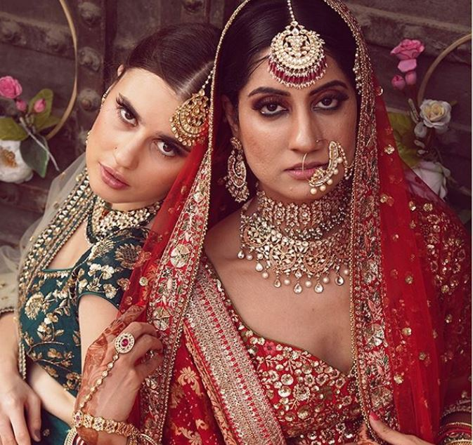 Bride in Red and Bridesmaid in Green Ethnic Outfits