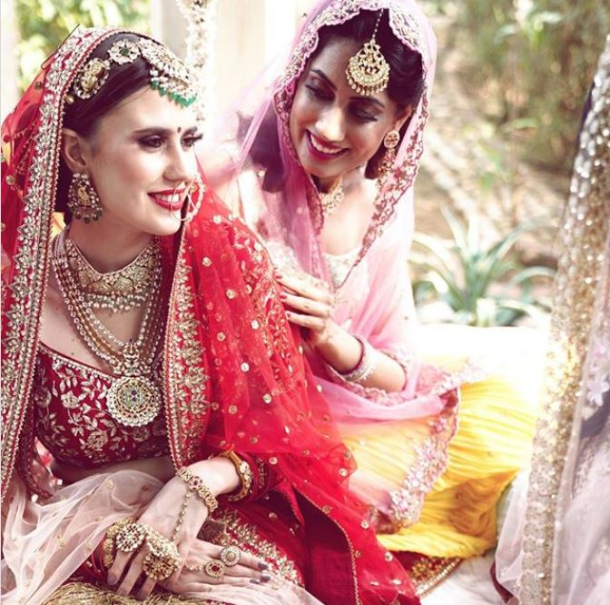 Bride in Red and Bridesmaid in Pink Outfits