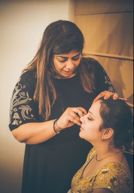 Makeup Artist Making the Bride Ready for Wedding
