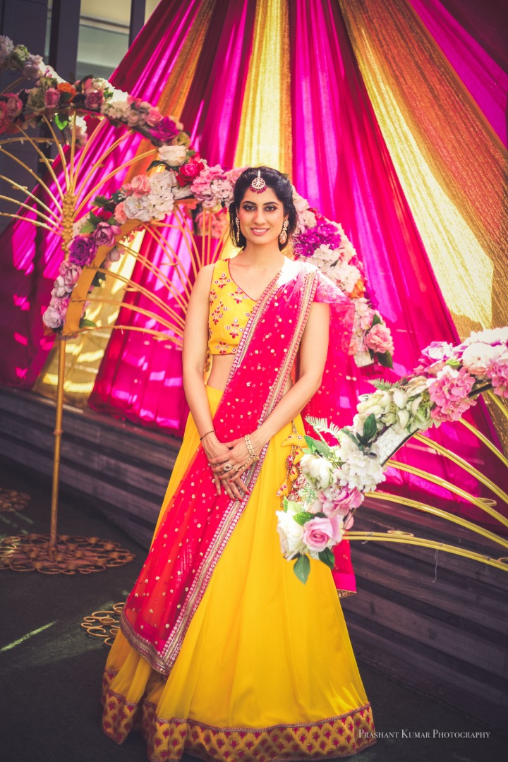 Bride in Yellow and Pink Outfit For Mehendi Ceremony