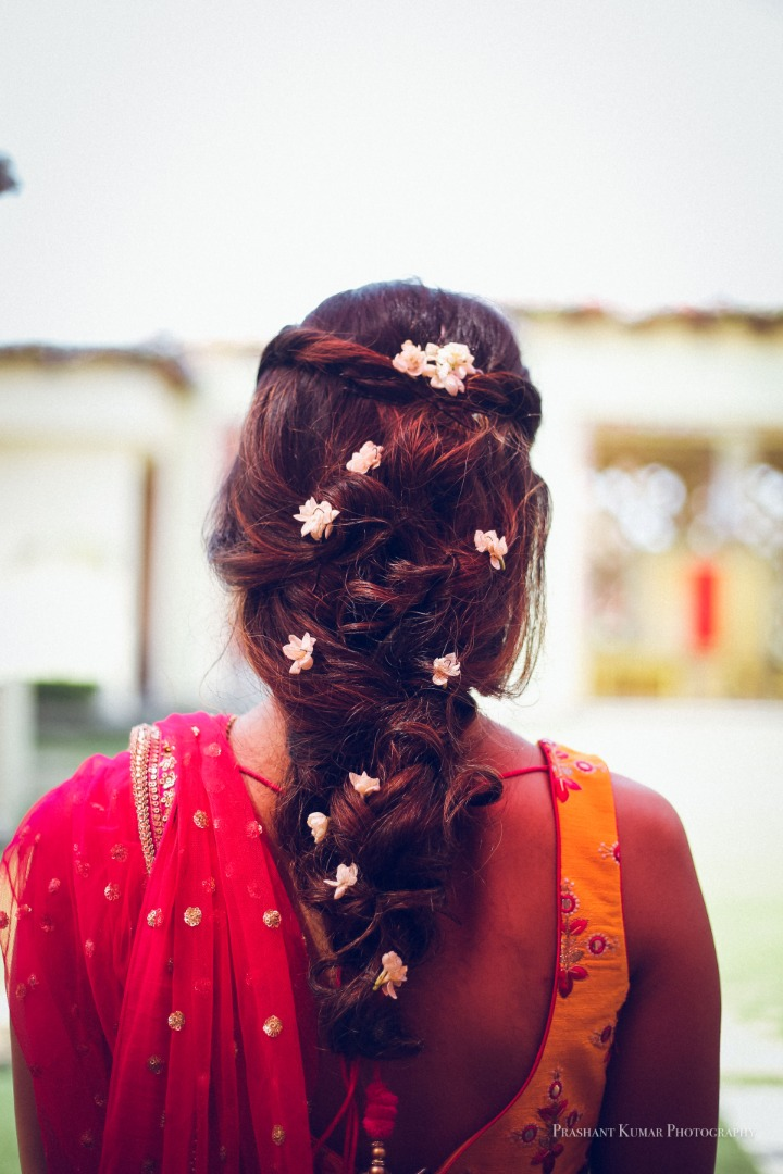 Fishtail Hairstyle with Flower Adornments