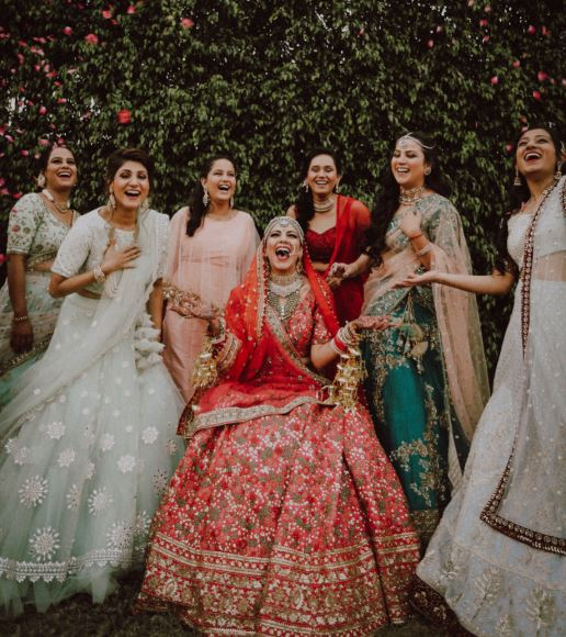 Bride Laughing & Posing with Bridesmaids