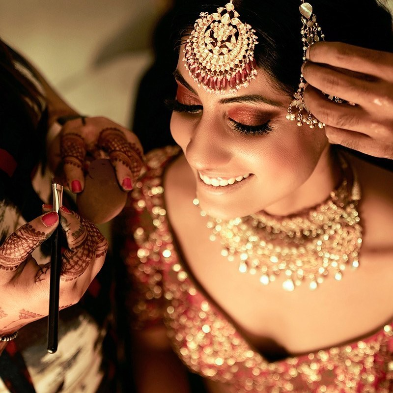Beautiful Bride Getting Ready For Wedding in Red Lehenga and Nude Makeup