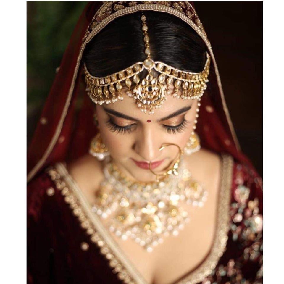 Royal Classic Indian Bridal Makeup with Red Lehenga