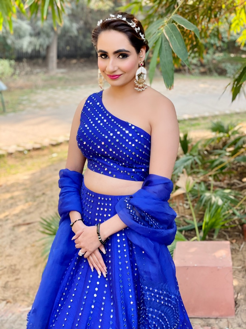 bride in a contemporary blue outfit
