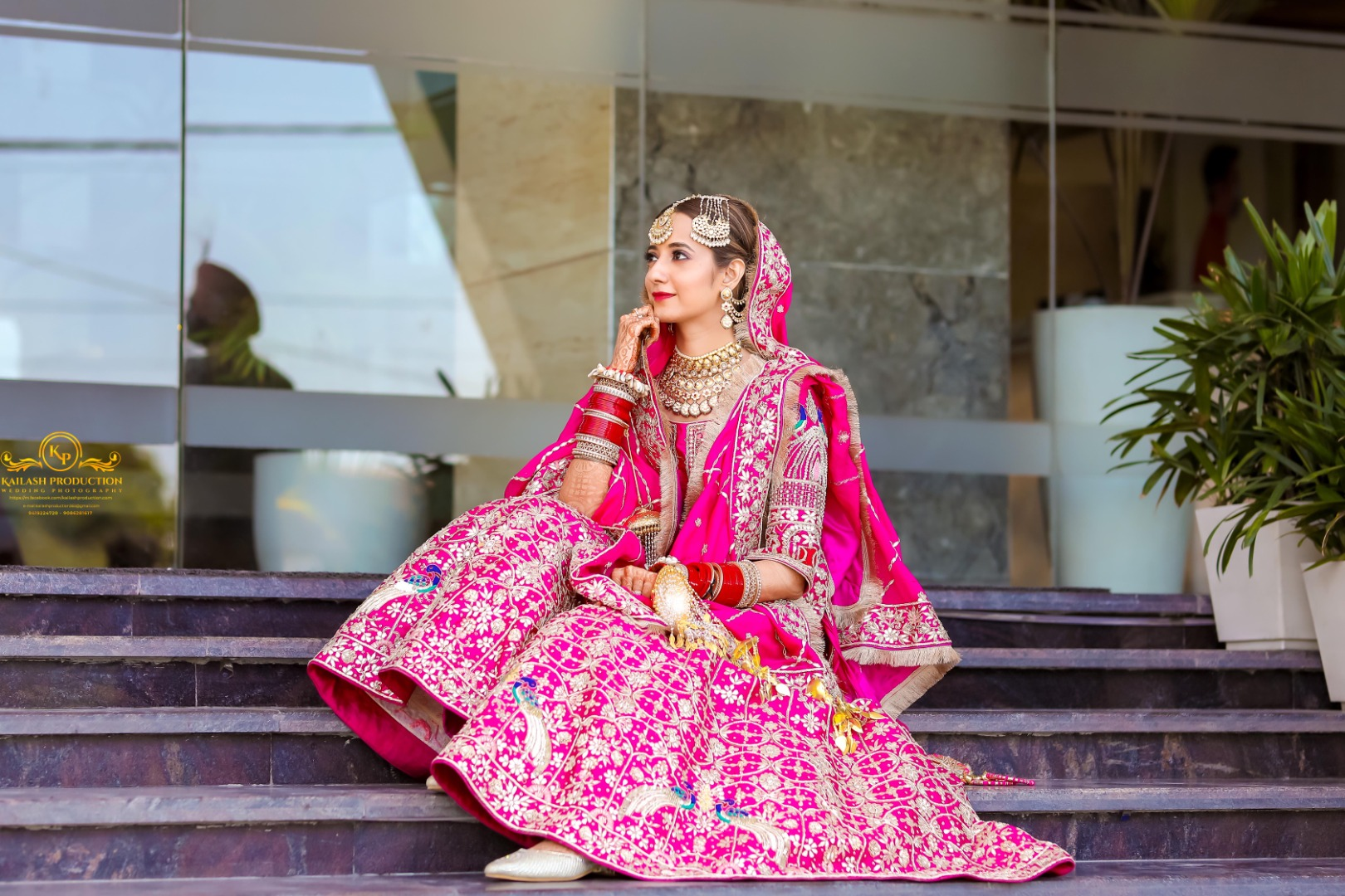 bride in red lehenga and heavy jewelry