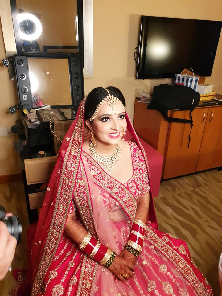 Happy Bride while getting dolled up