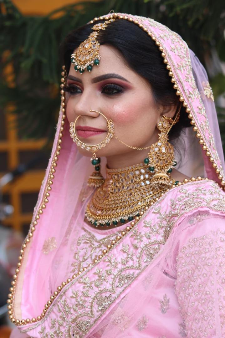 beautiful punjabi bride in pastel pink outfit