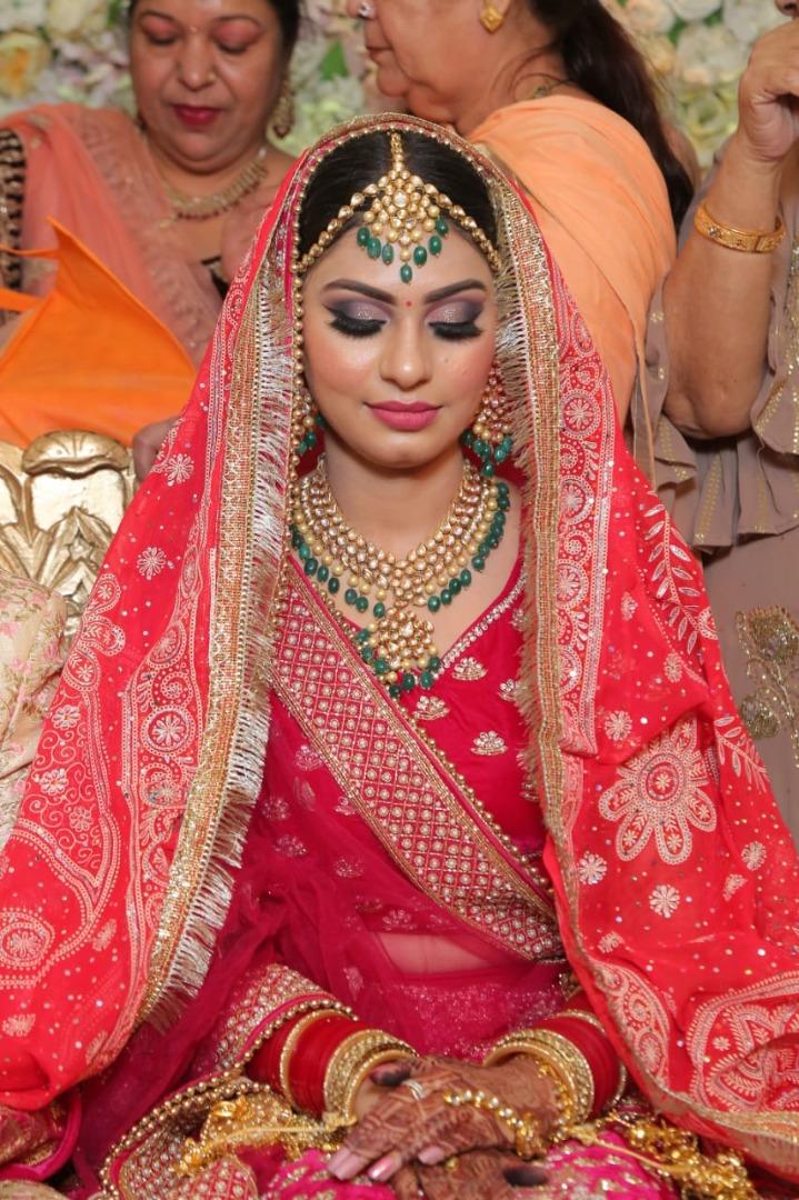 blushing bride in red