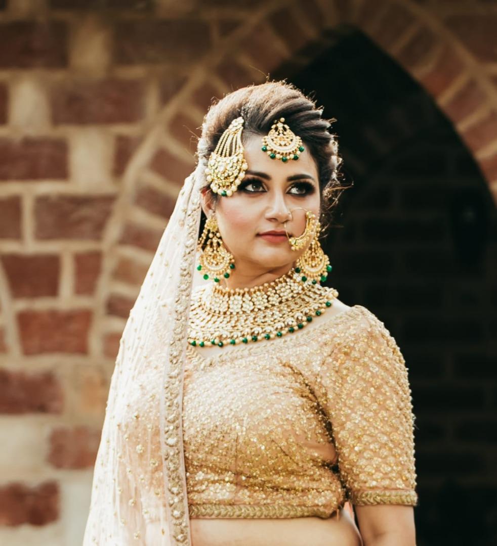 bride in golden lehenga