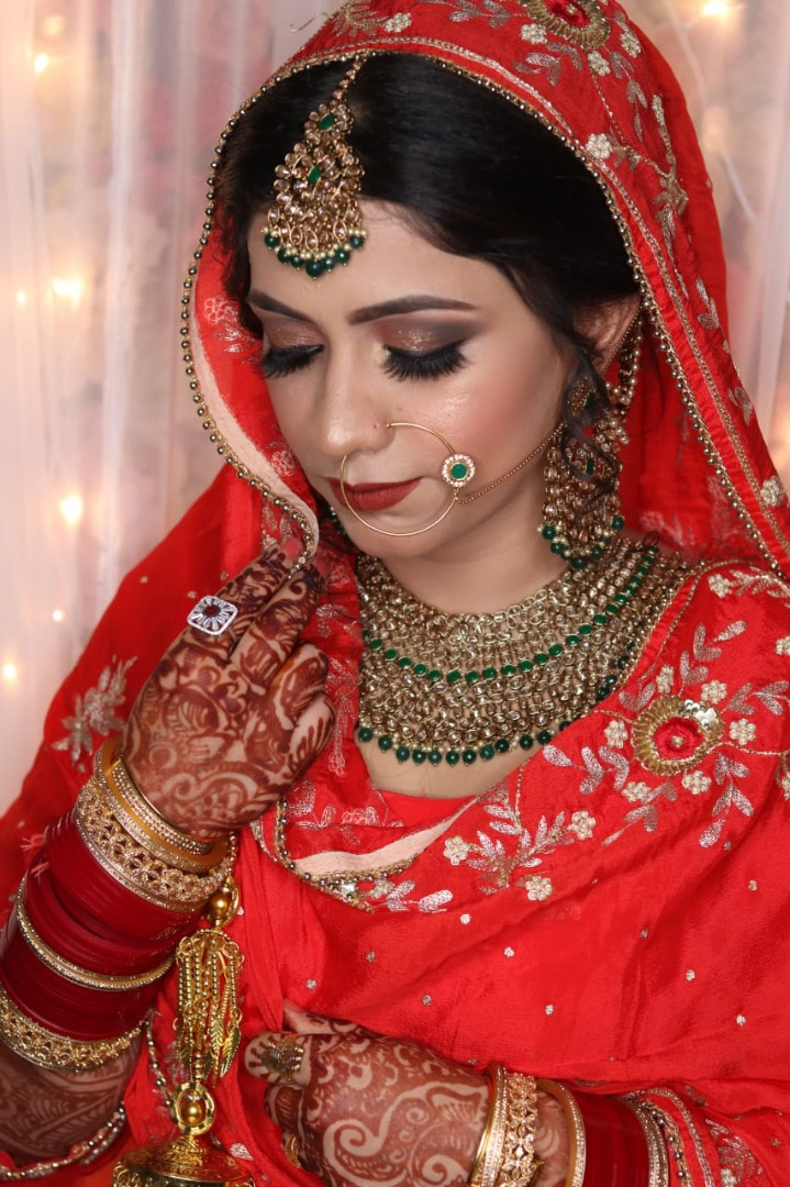 beautiful bridal shot of the bride with stunning makeup and false lashes