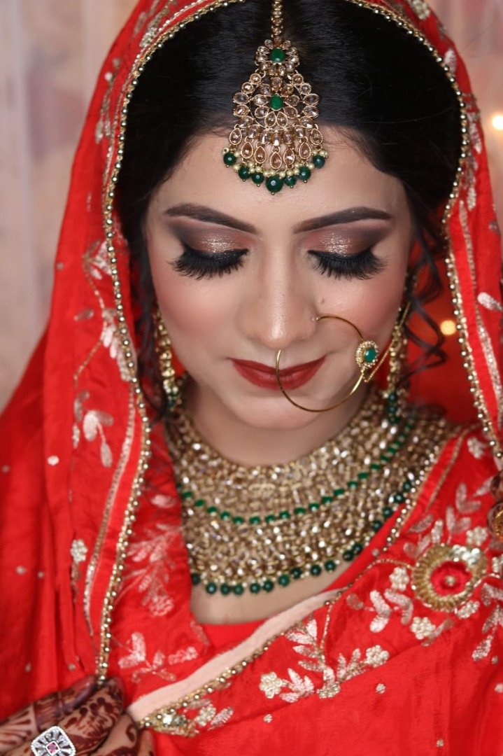 bride in red with stunning bridal makeup