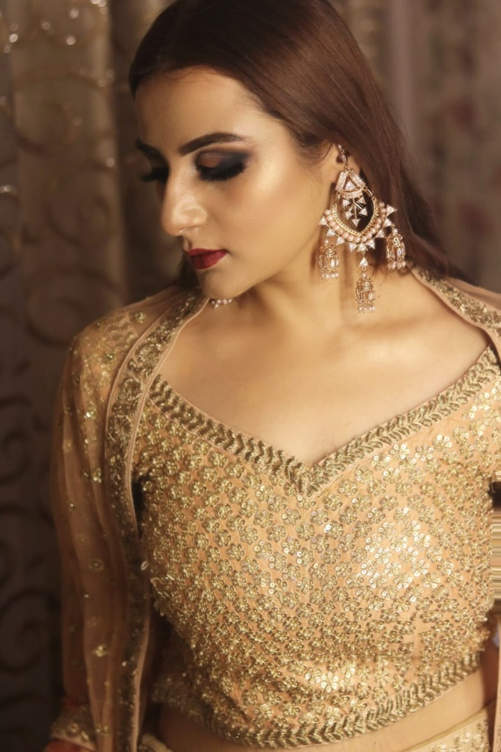 bride in golden outfit