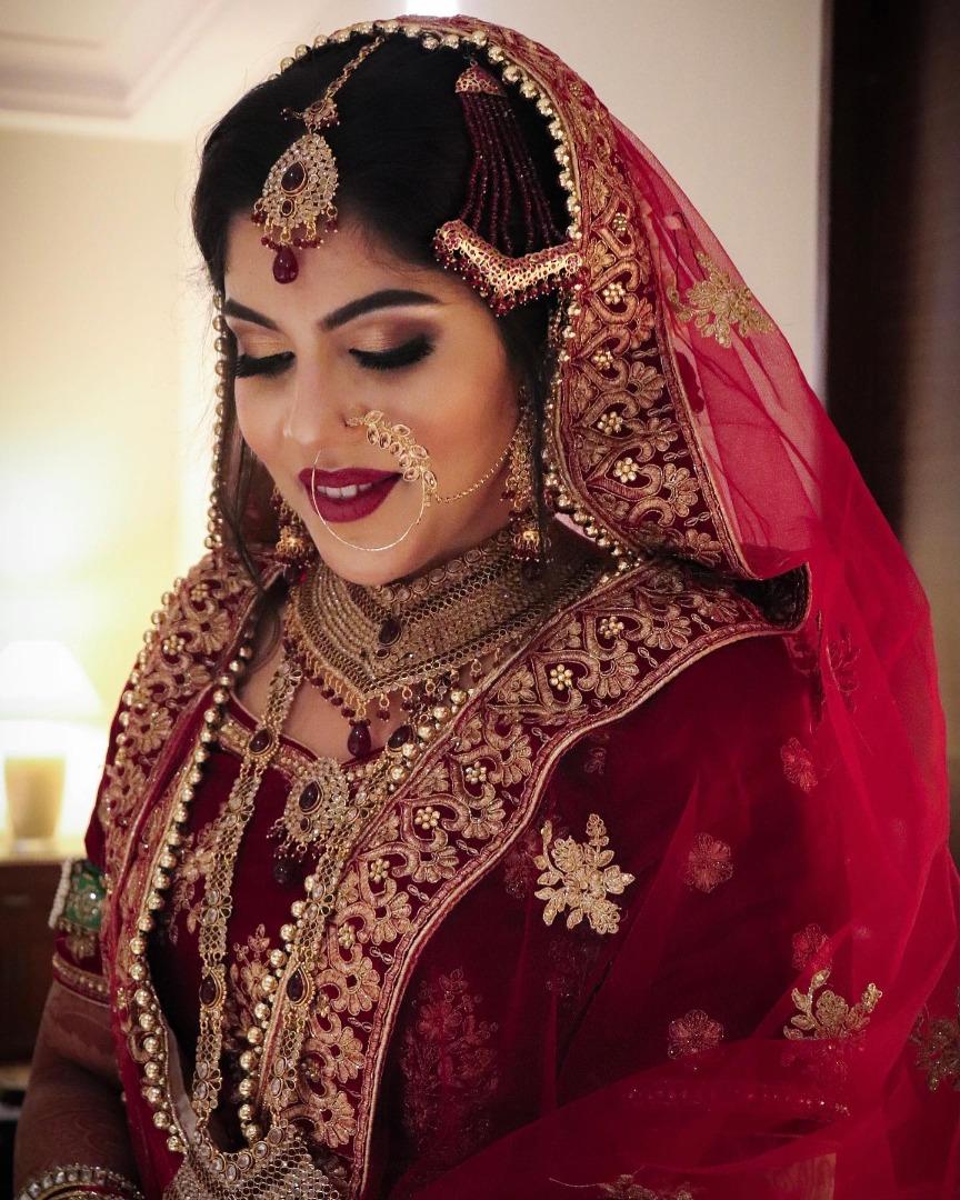 muslim bride in smokey gold eye and bold red lip makeup