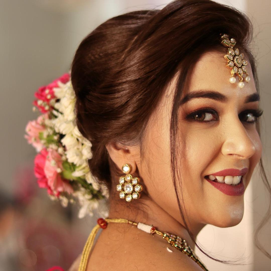 bride in natural pink makeup and floral bridal bun