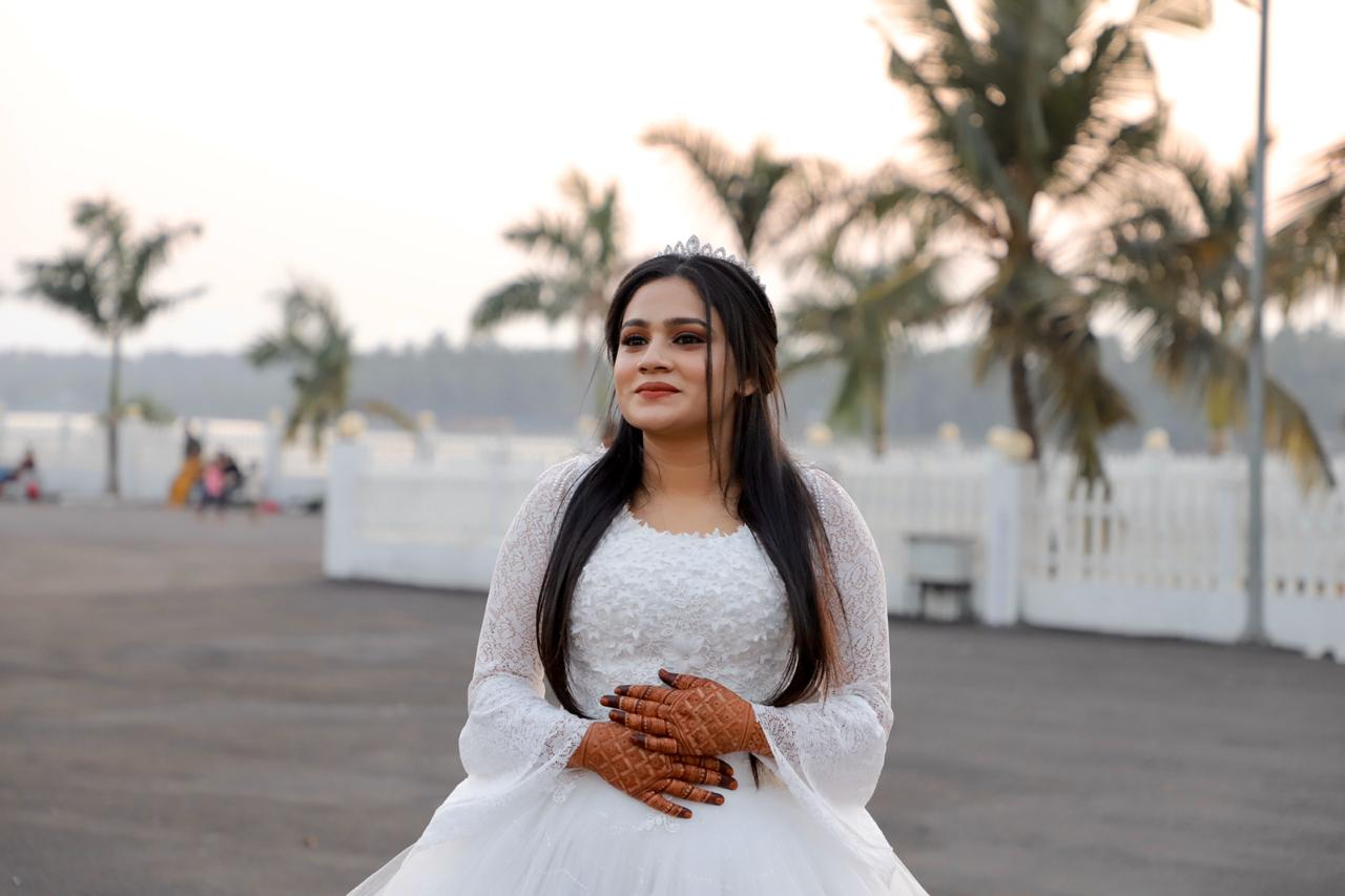 bride in a white outfit
