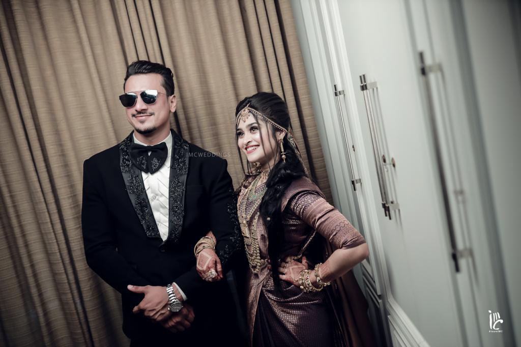 bride in purple silk saree and gold jewelry