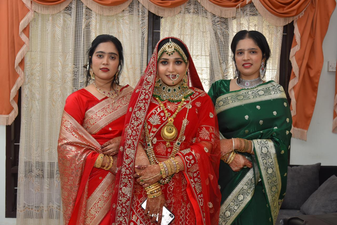 bride in red poses with her family