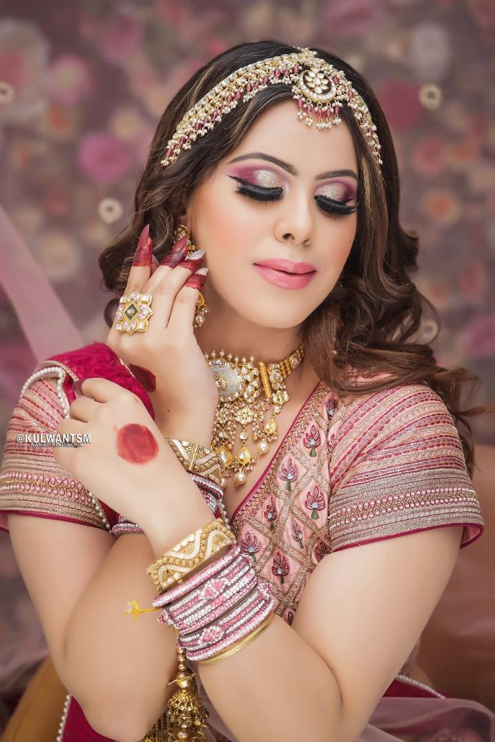 bride in pink bridal lehenga with pink bridal makeup
