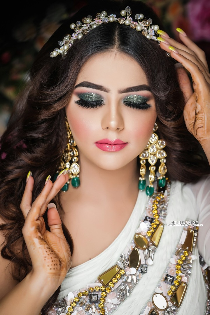 bride in emerald eye makeup and pink lips