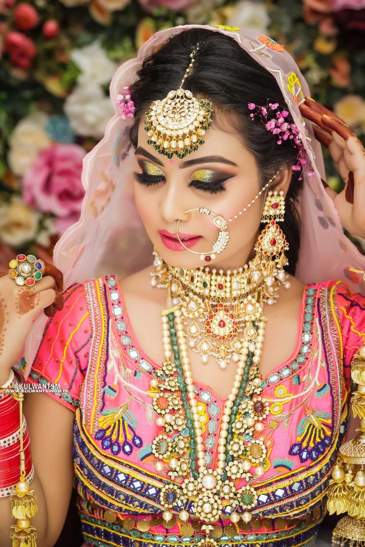 bride in vibrant lehenga and contrasting jewellery