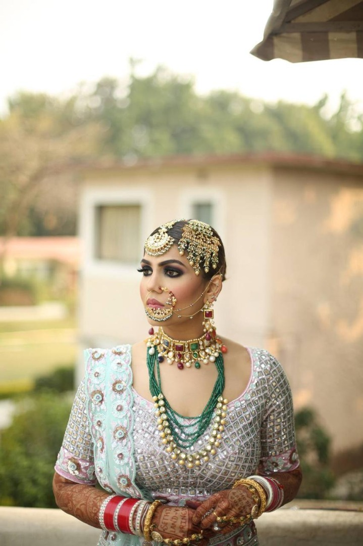 bride in powder blue lehenga