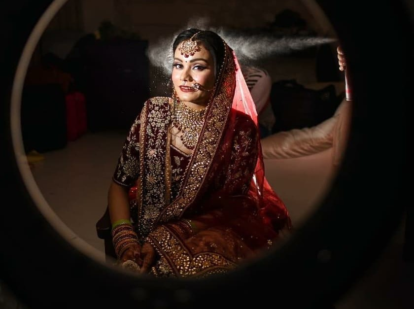 Beautiful bride getting ready in Red Lehenga
