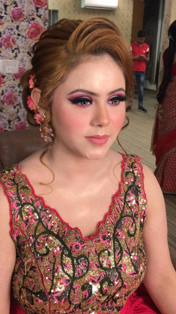 bride in a glorious pink golden lehenga