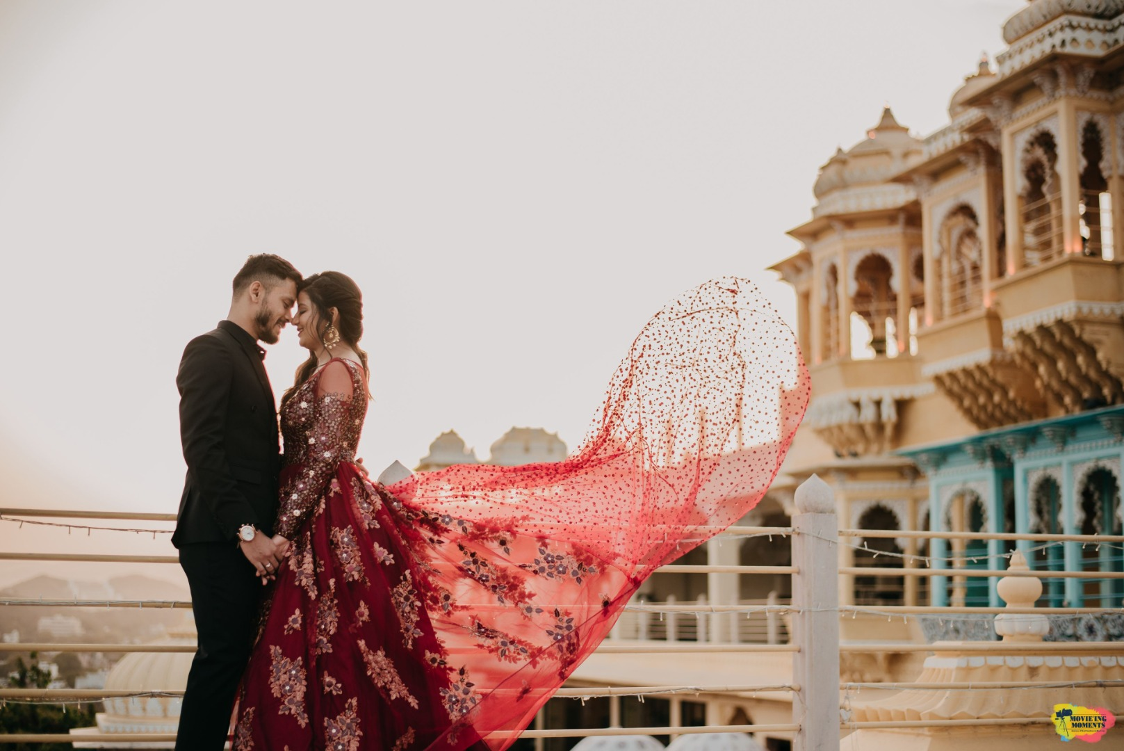 couple in contrasting outfits at their pre wedding shoot