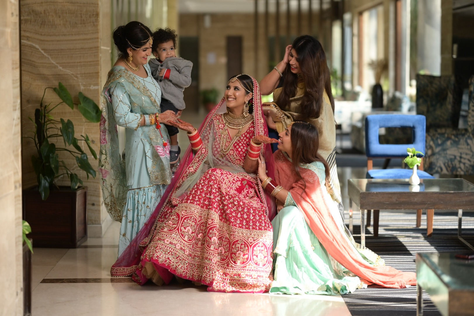 bride in pink poses with her fam