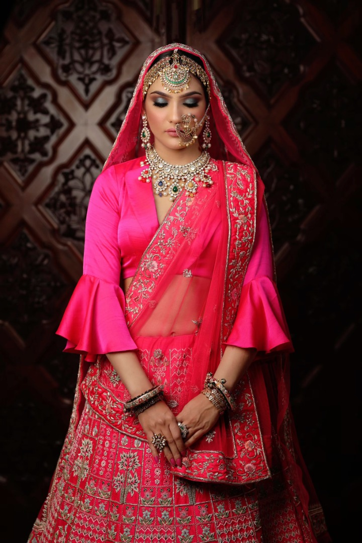 bride in pink lehenga and contrasting jewelry