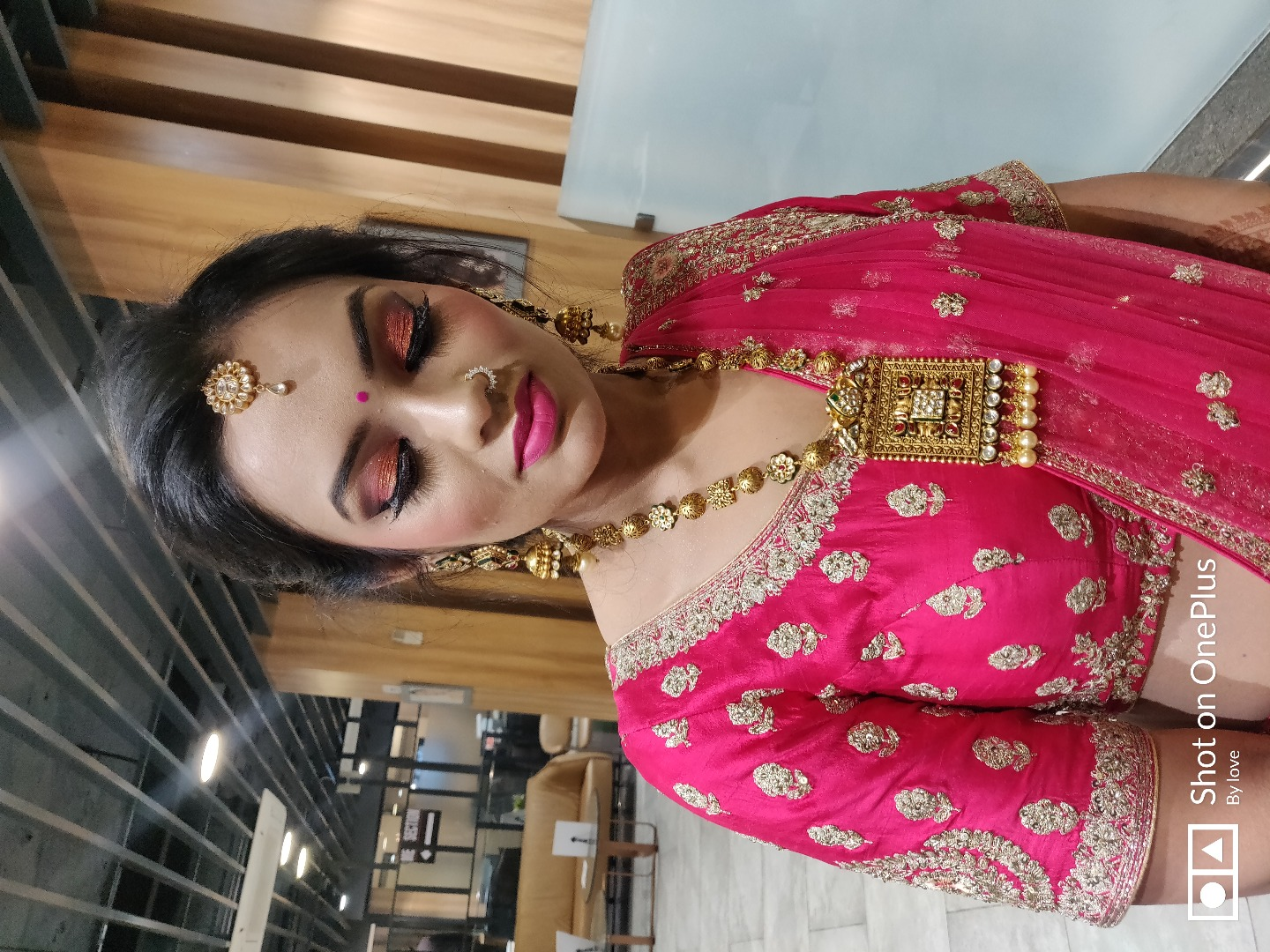 bride in red gown with nude makeup