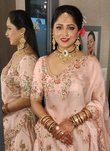 bride in natural pink makeup with pastel outfit