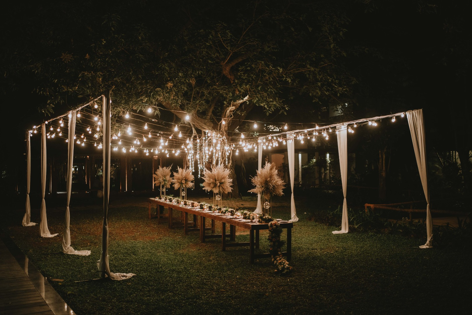 beautiful table set up dried flowers and candles