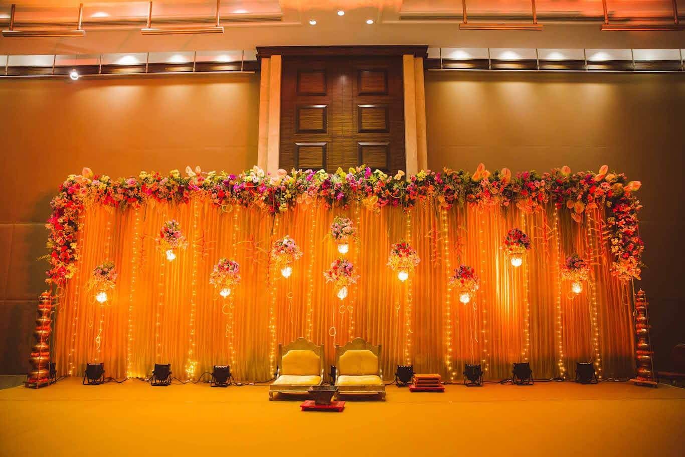 Fairy Lights & Hanging Floral Baskets Wedding Stage Decor