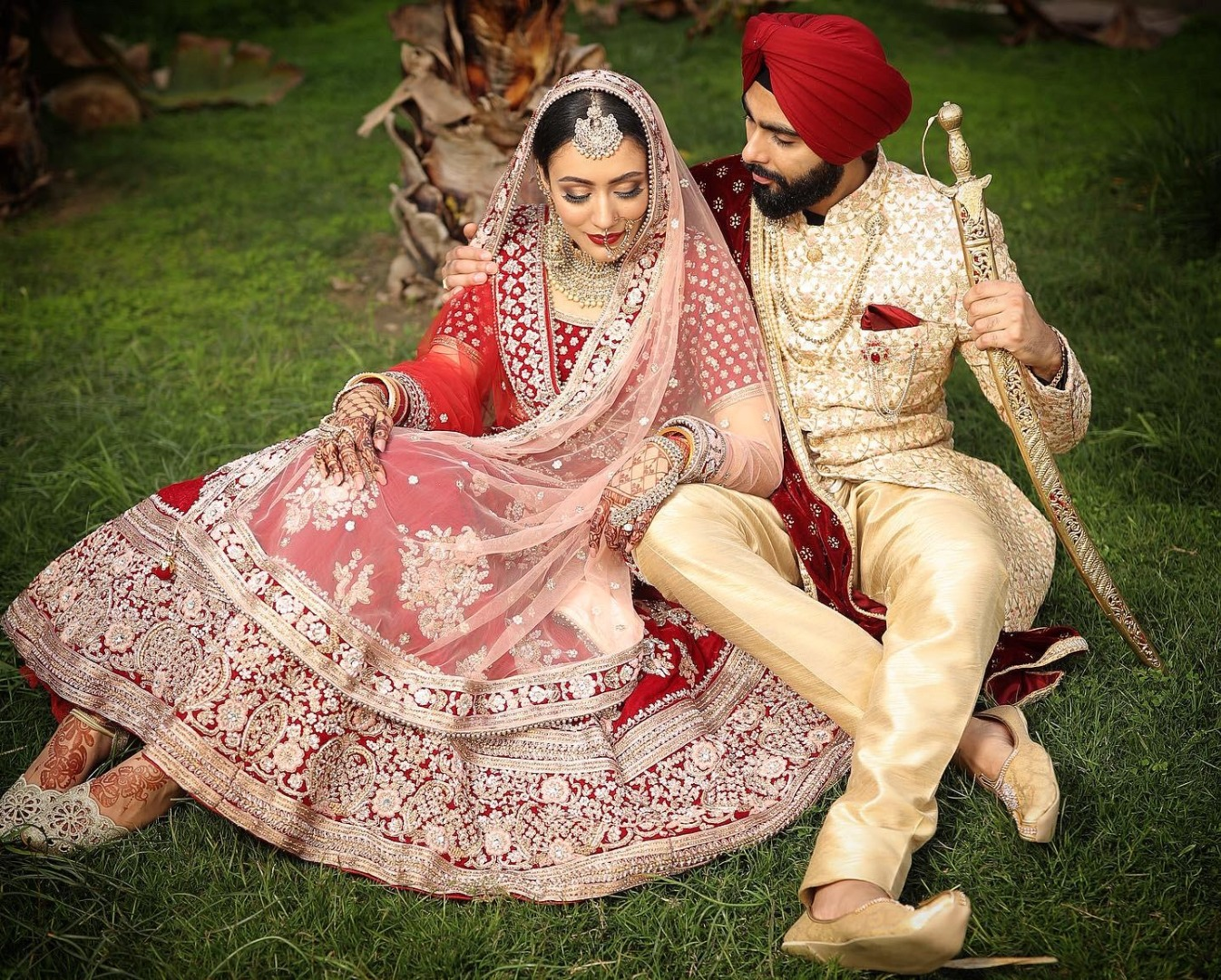 Beautiful Sikh Bride Smiling in Pink and White lehenga