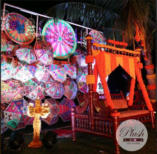 Colorful Umbrellas and Yellow Marigold Swing Seating Mehendi Ceremony Decor
