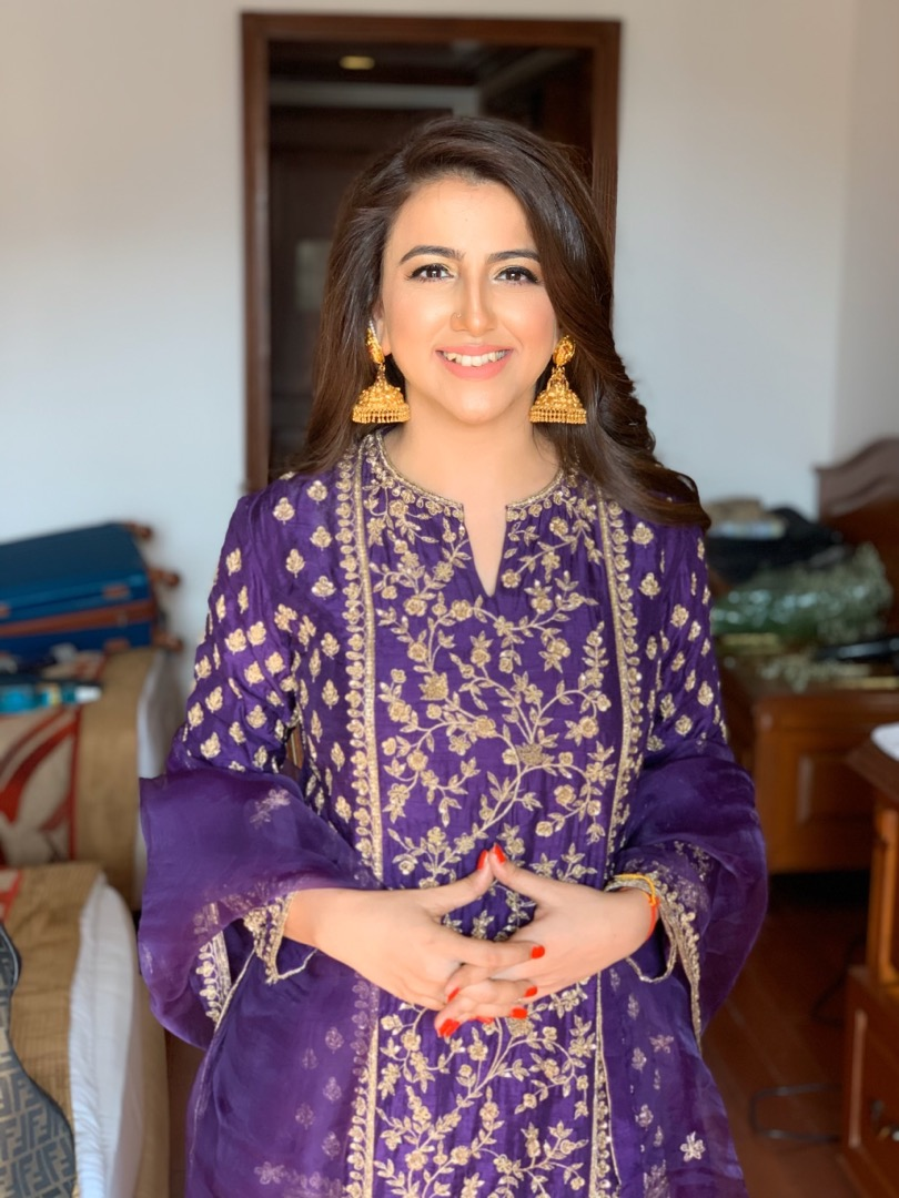 bride in a purple traditional suit