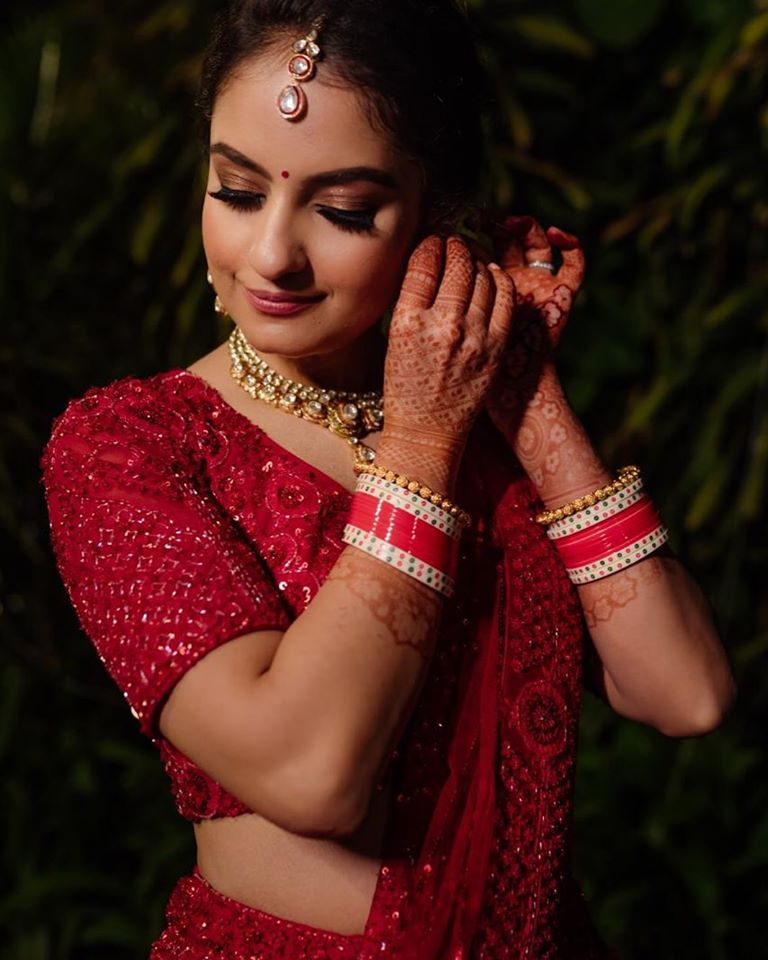 Bdautiful Indian Bride in Red Lehenga & Soft Pink Bridal Makeup