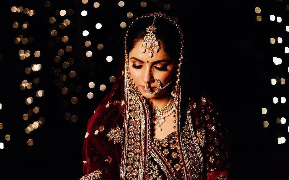 Beautiful Punjabi Bride in Deep Red Wedding Outfit, Subtle Makeup & Gold Jewelry & Kaleeras