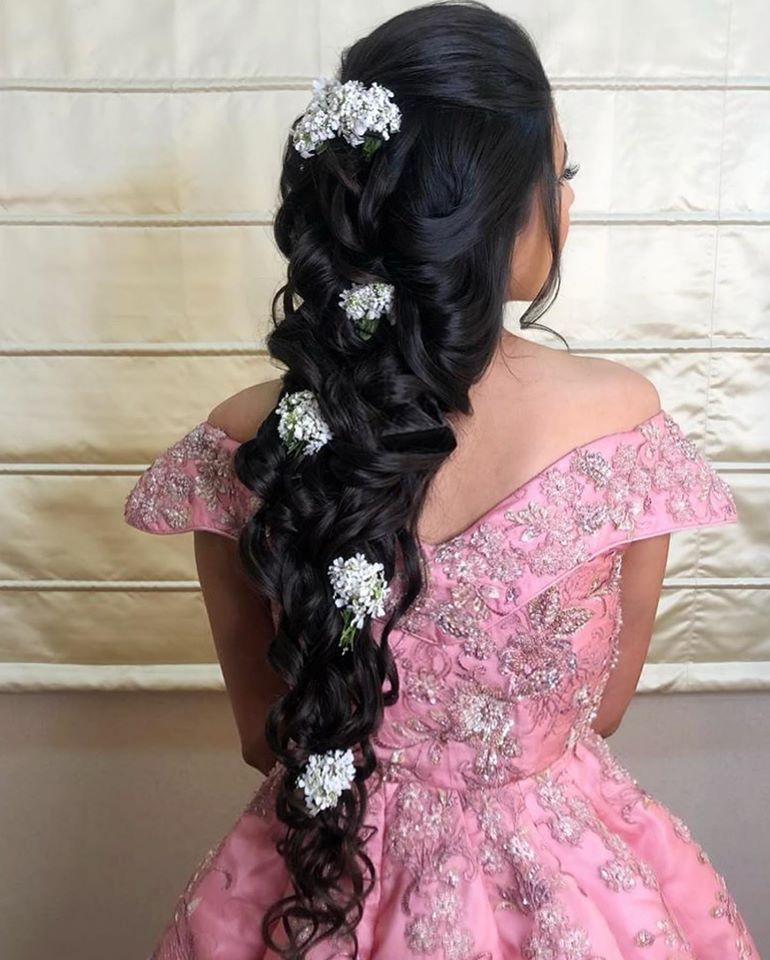 Bride in a Princess Braid Hairstyle with Baby Breath Flowers & Pink Disney Princess Dress