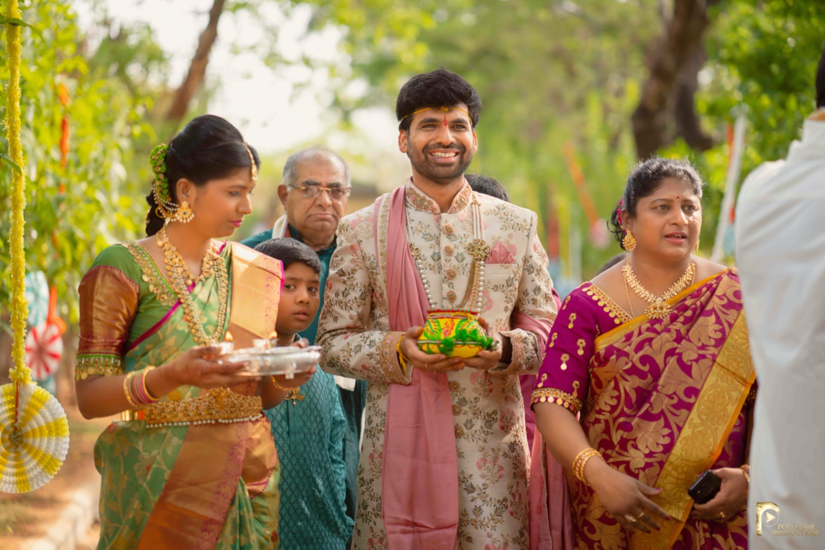 groom in yellow outfit at his haldi