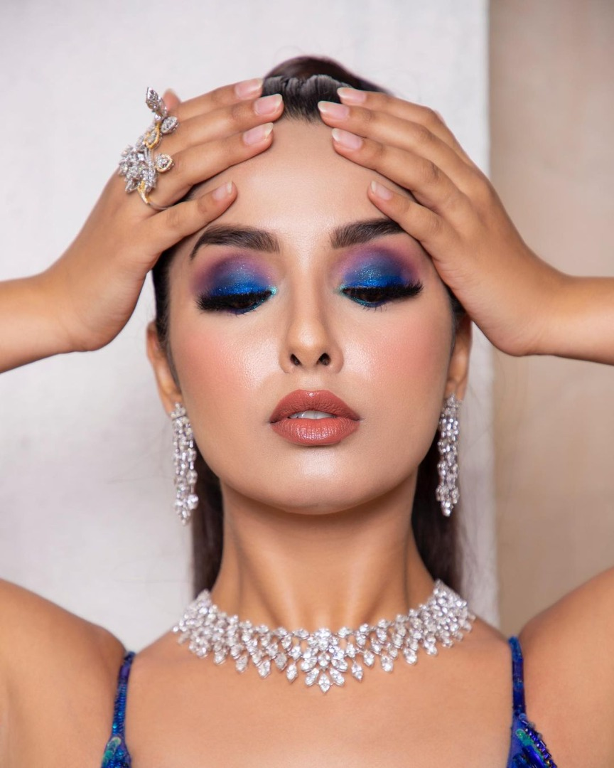bride in statement eye makeup with nude lips