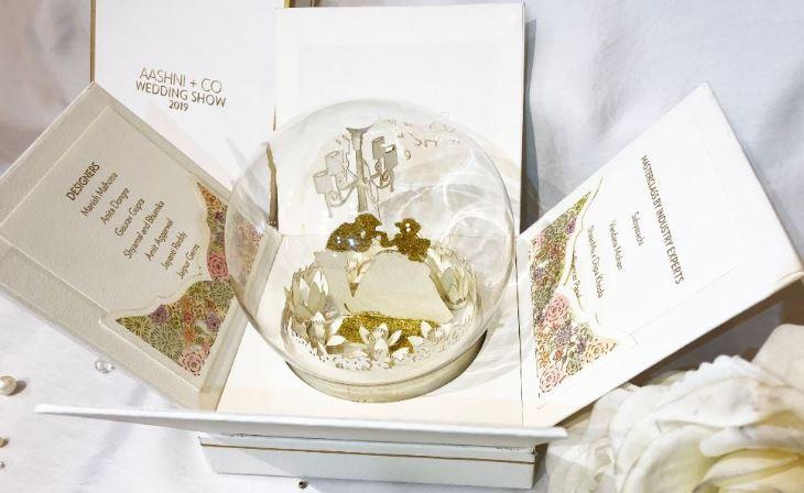 White & Gold Wedding Show Invite