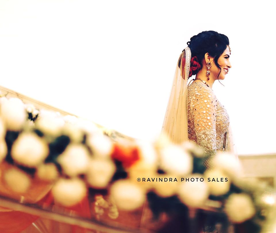 Beautiful Bride Candid Picture in Gold Lehenga and Red Rose Bun