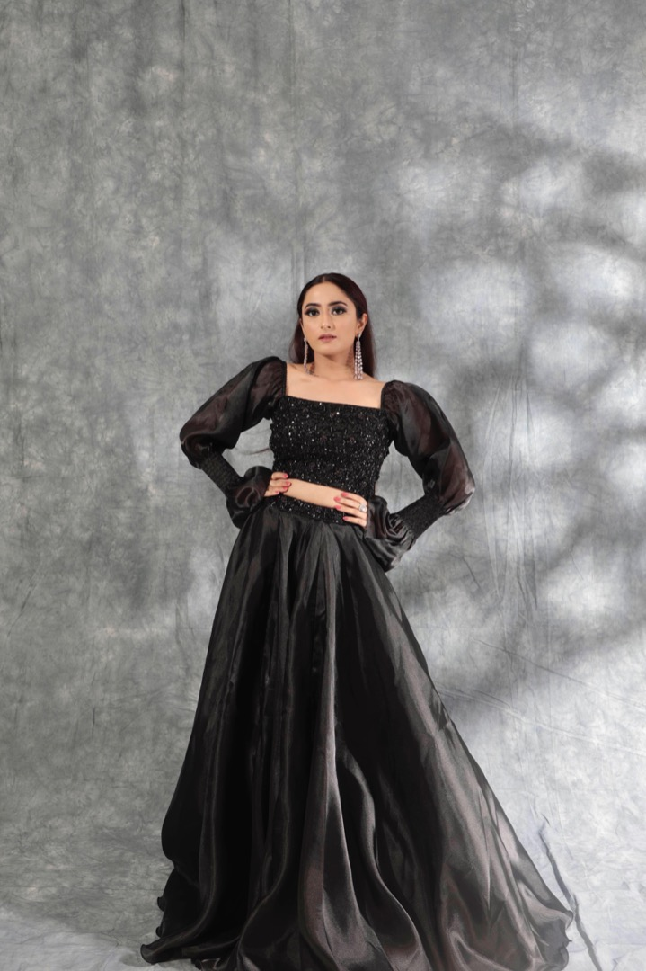 bride in a black gown with statement sleeves