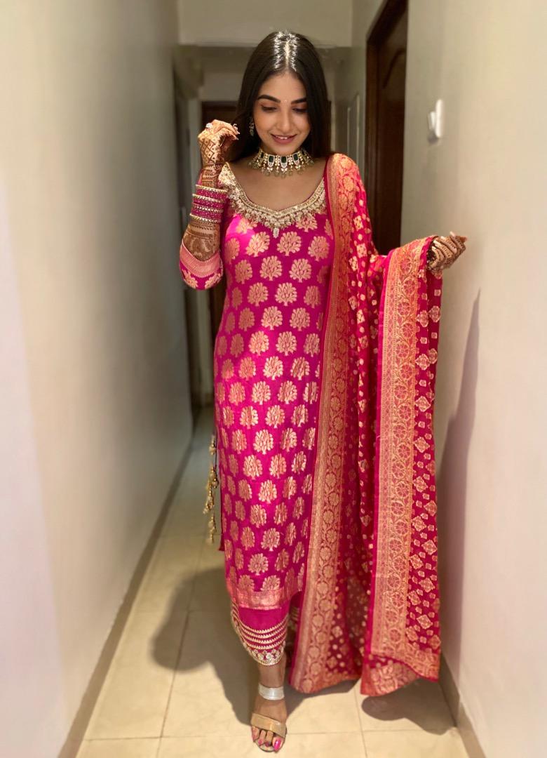 bride in pink banarsi suit